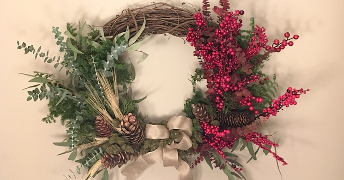 This holiday wreath comes with some extra-special flowers. Hint: It's weed